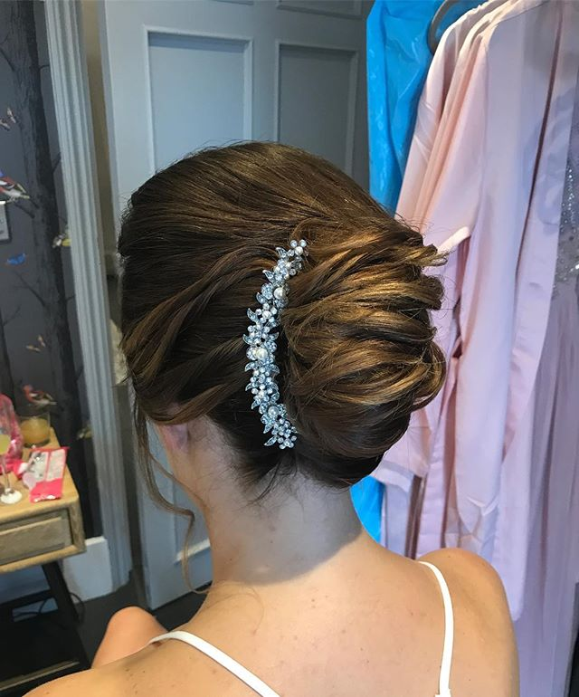 Loose French pleat for beautiful bride K