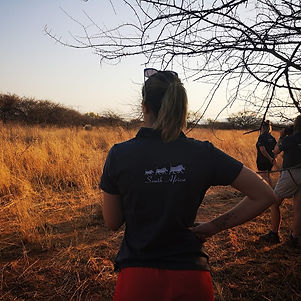 Female Conservationist Viewing Rhino