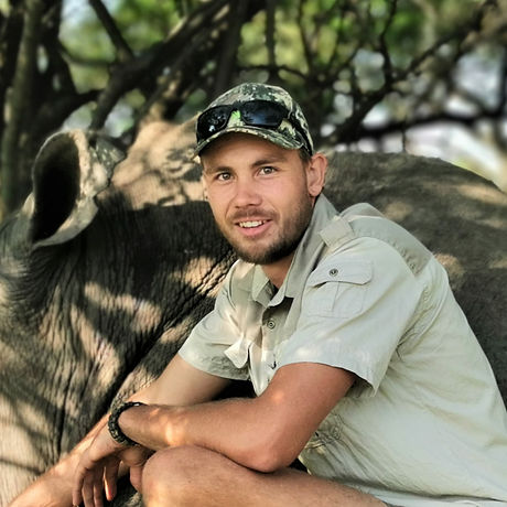 Game Ranger Smiling With Rhino