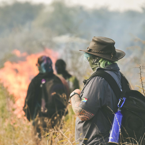 Volunteers Monitoring A Controlled Burn