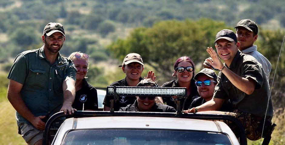 Volunteers On Back Of Vehicle