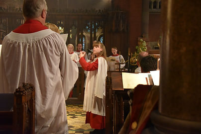 Katelyn Emerson conducting the choir at the Church of the Advent in Boston