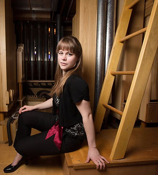 Katelyn Emerson inside the Fisk organ at Oberlin College's Finney Chapel