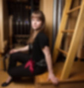 Katelyn Emerson inside the Fisk organ at Oberlin College's Finney Chapel