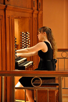 Katelyn Emerson at the Fisk organ console of Oberlin College's Finney Chapel