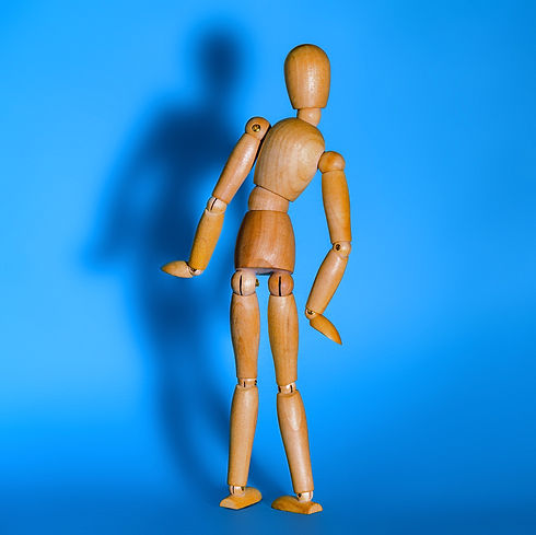 Back%20pain%20concept.%20wooden%20toy%20man%20with%20scoliosis._edited.jpg