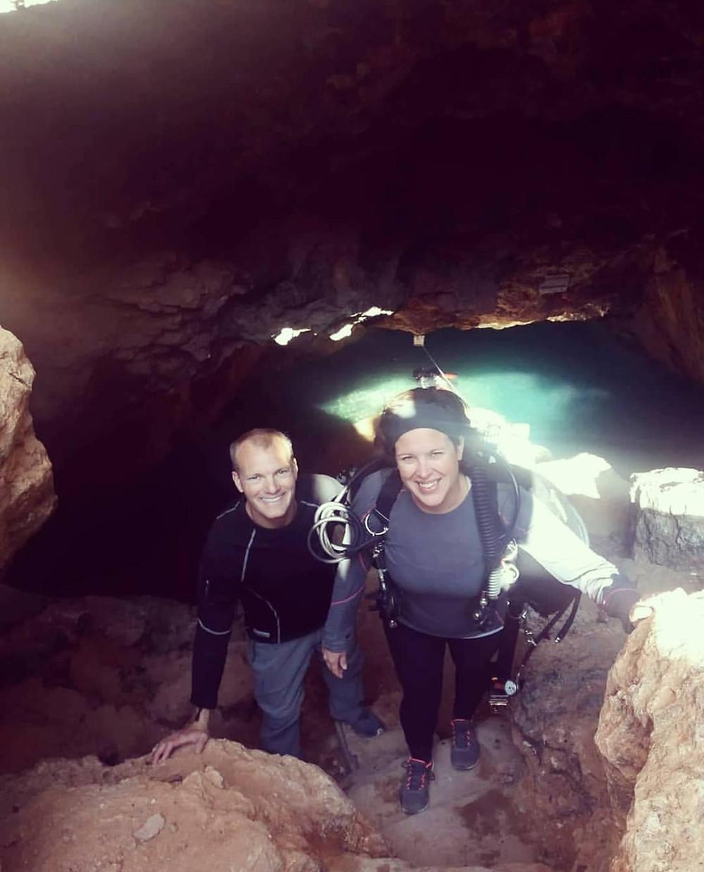 Climbing the stairs in Cueva del Aqua