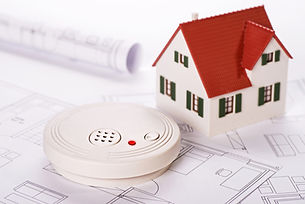 Smoke detector with house and blueprints