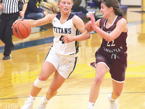 Ritter becomes Titan girls' all-time leading scorer
