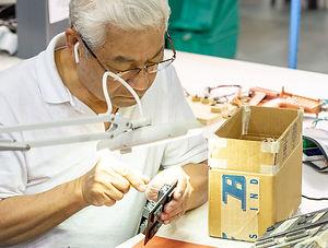 man working on printed circuit board