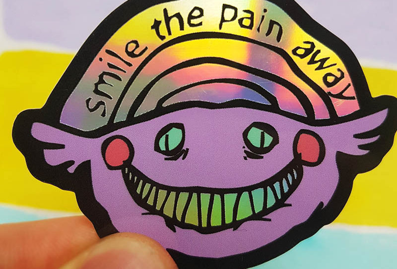 Smile the pain away sticker (holographic)