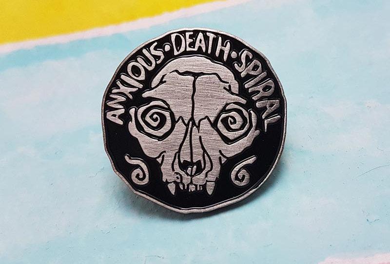 Anxious Death Spiral lapel pin