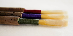 Three oboe reeds that are cheap.