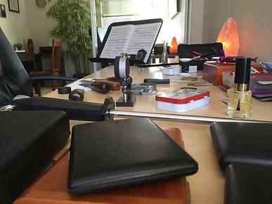Oboe reeds for sale on a desk.