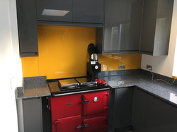 yellow splashback with red oven