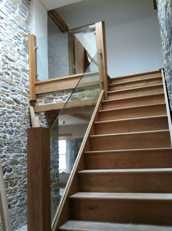 Wooden stairs glass bannister