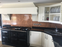 copper textured black and white kitchen