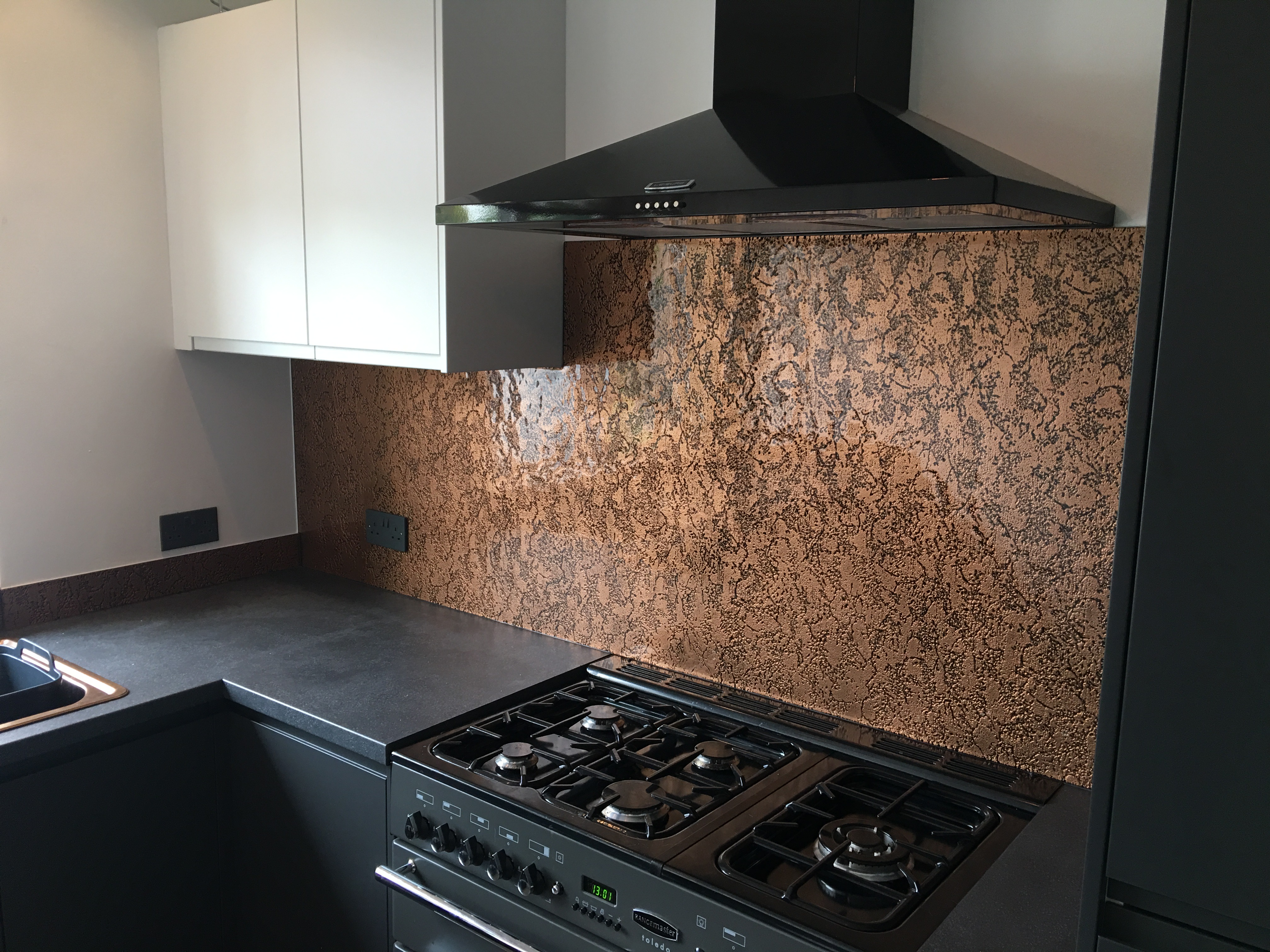 copper textured black cooker