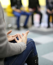 Closeup of hands at a counselling session
