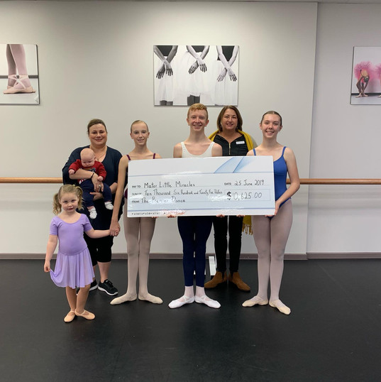 Presenting our cheque to Mater Little Miracles