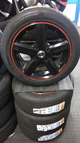 "15"" FORD FIESTA, BLACK/RED ALLOYS WITH 195/50X15 TYRES"