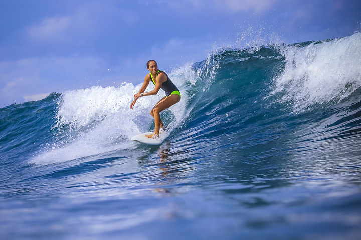 Surfer Girl On Amazing Blue Wave.jpg