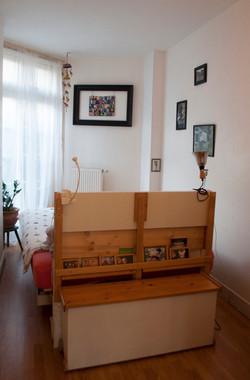 BED AND CRIB NARROW ROOM