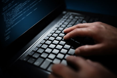 programmer-or-computer-hacker-typing-on-