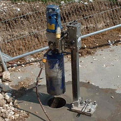 diamond drill rig drilling 225mm diameter hole through reinforced concrete