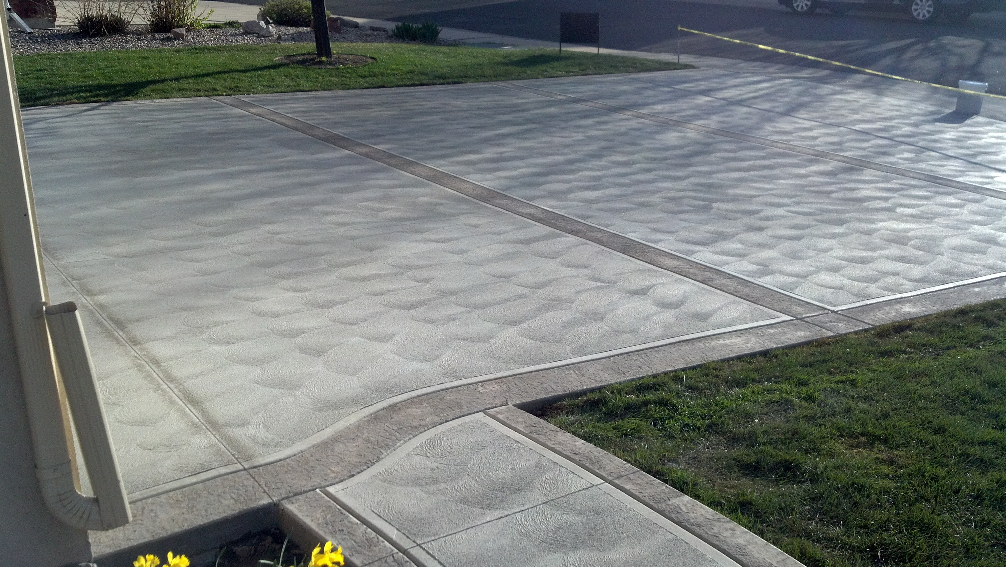 Sweat+finish,++with+Reg.+concrete+and+stamped++boarder.JPG