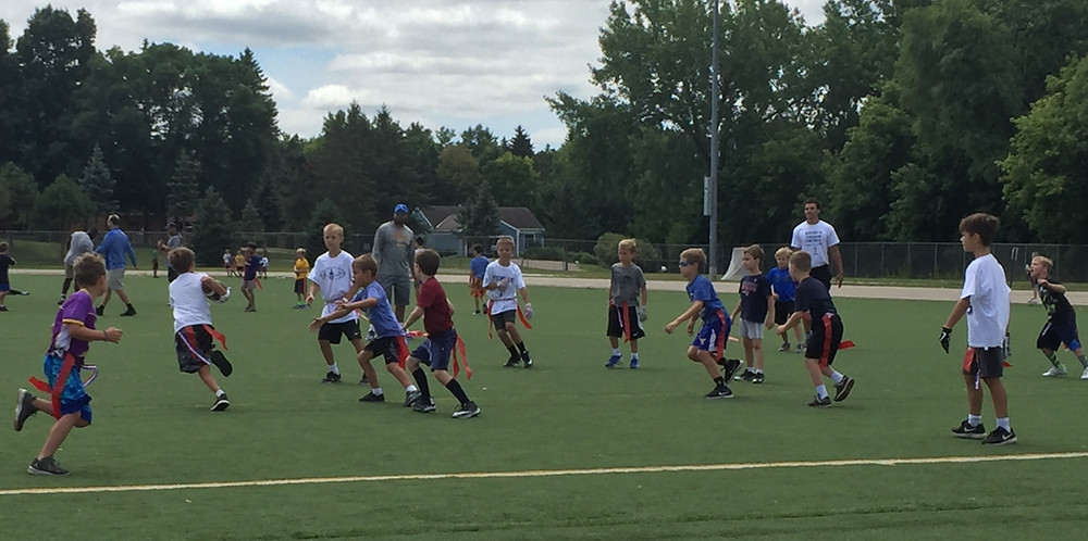 Youth football camp hosted by the local high school players and coaching staff