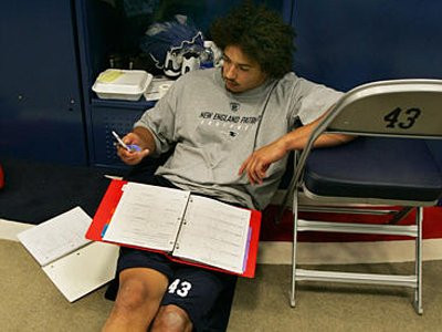 NFL Player studying the playbook
