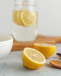 Sliced lemons and lemon water