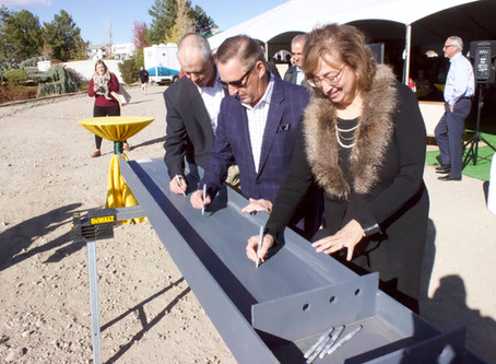 Village hosts girder signing and formal introduction