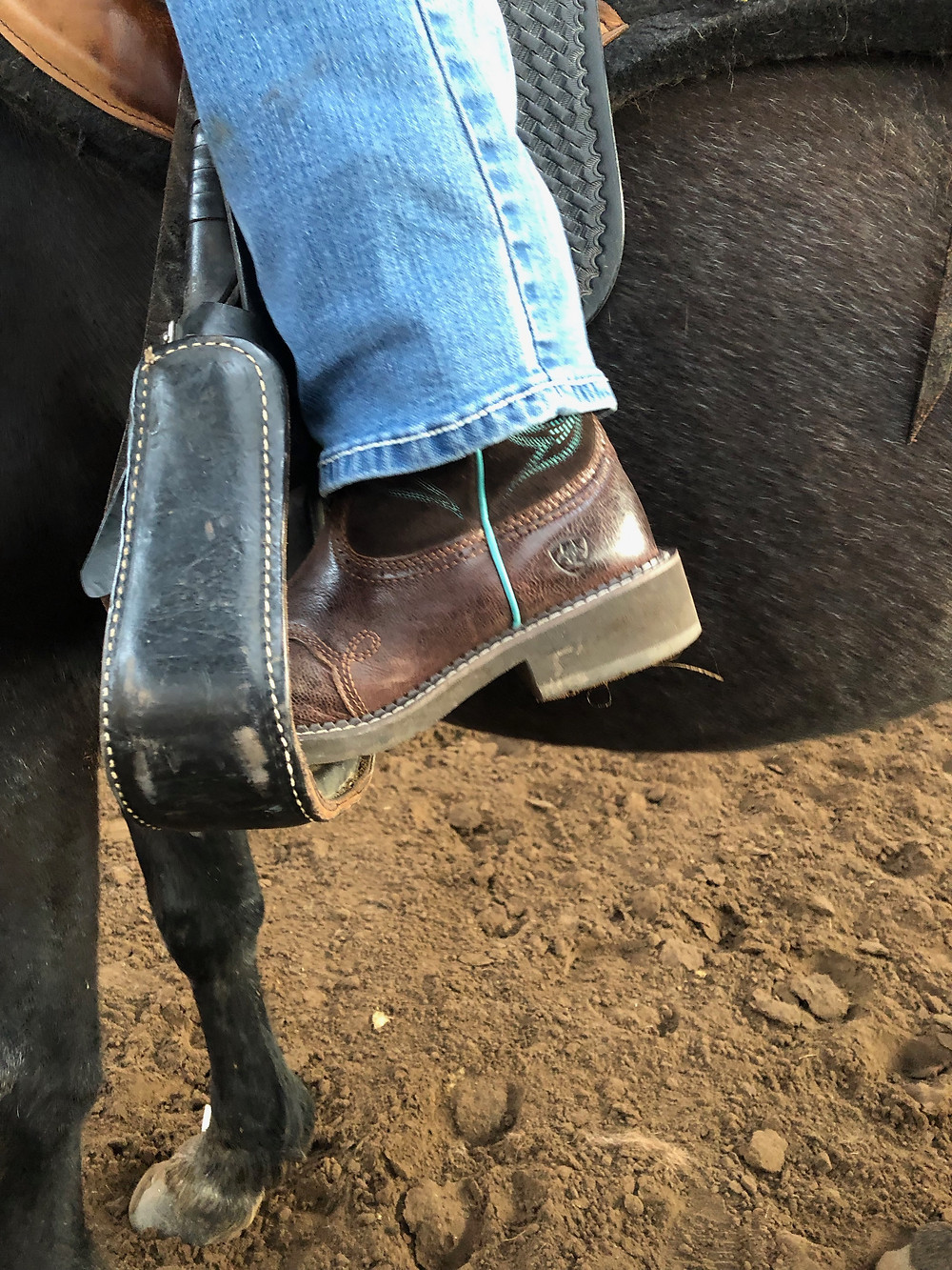 This is a dangerous way to ride.  When you ride on your toes, instead of your heels, you increase your chance of falling forward onto or over your horse's neck.