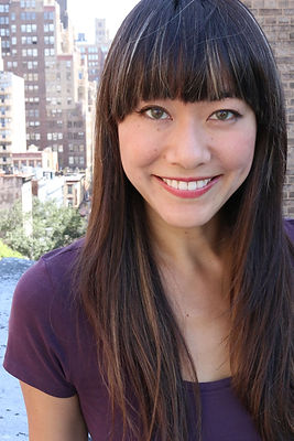 Laura Yumi Snell Headshot smiley NYC.jpg