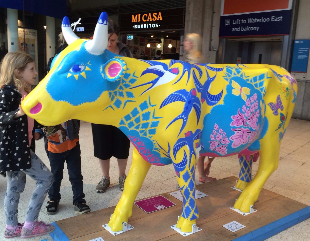 Colourful cow in Waterloo station