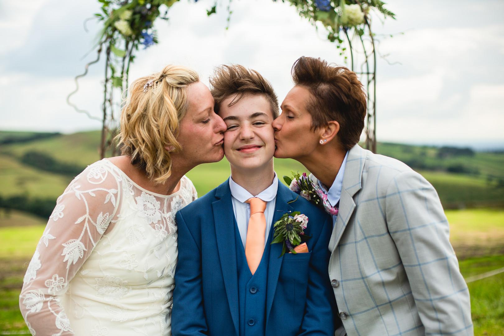 Couple kiss their son