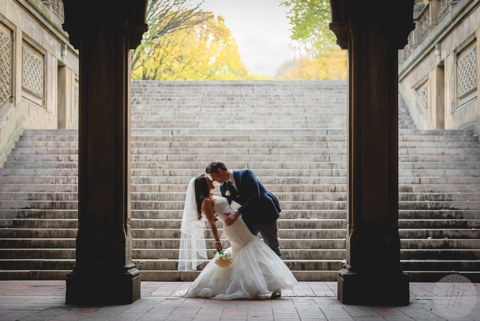Groom leans bride back