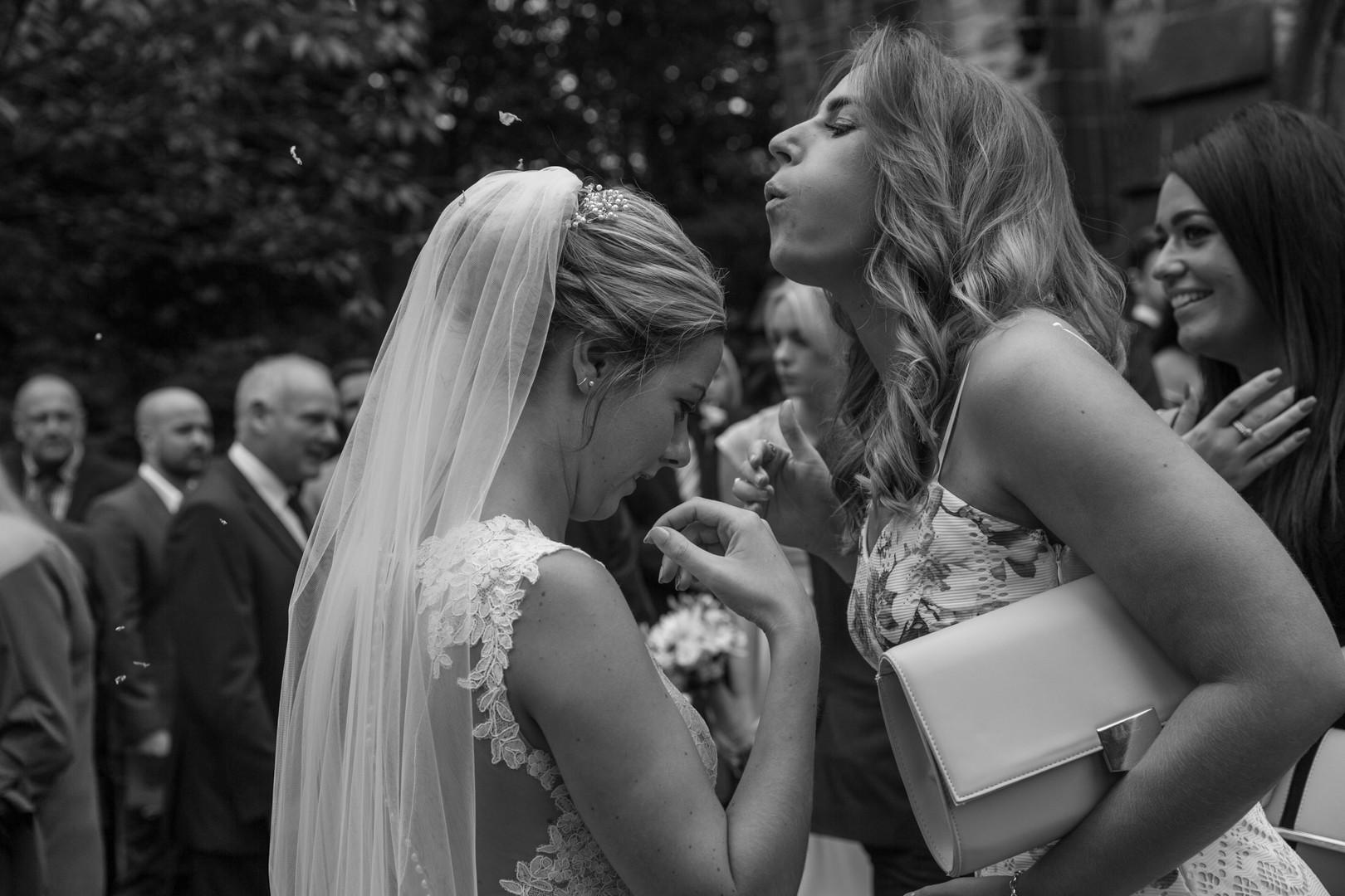 Bridemaid fixes brides hair