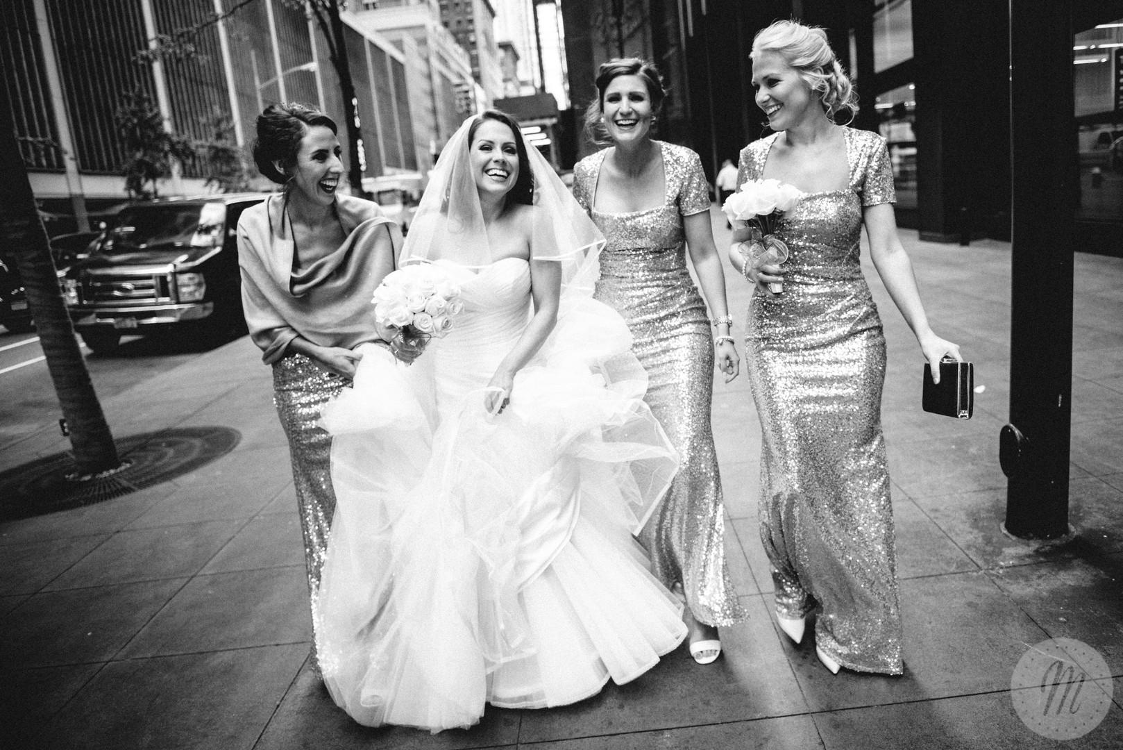 Bride walks down street