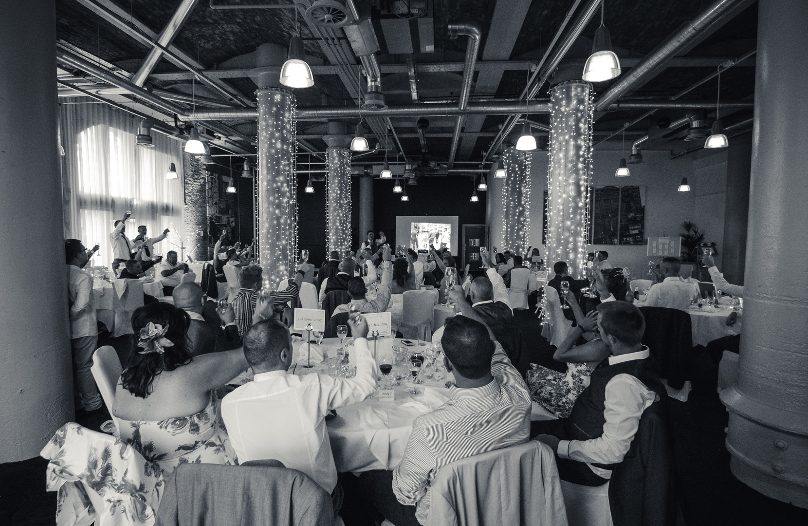 Room toasts newly wed couple