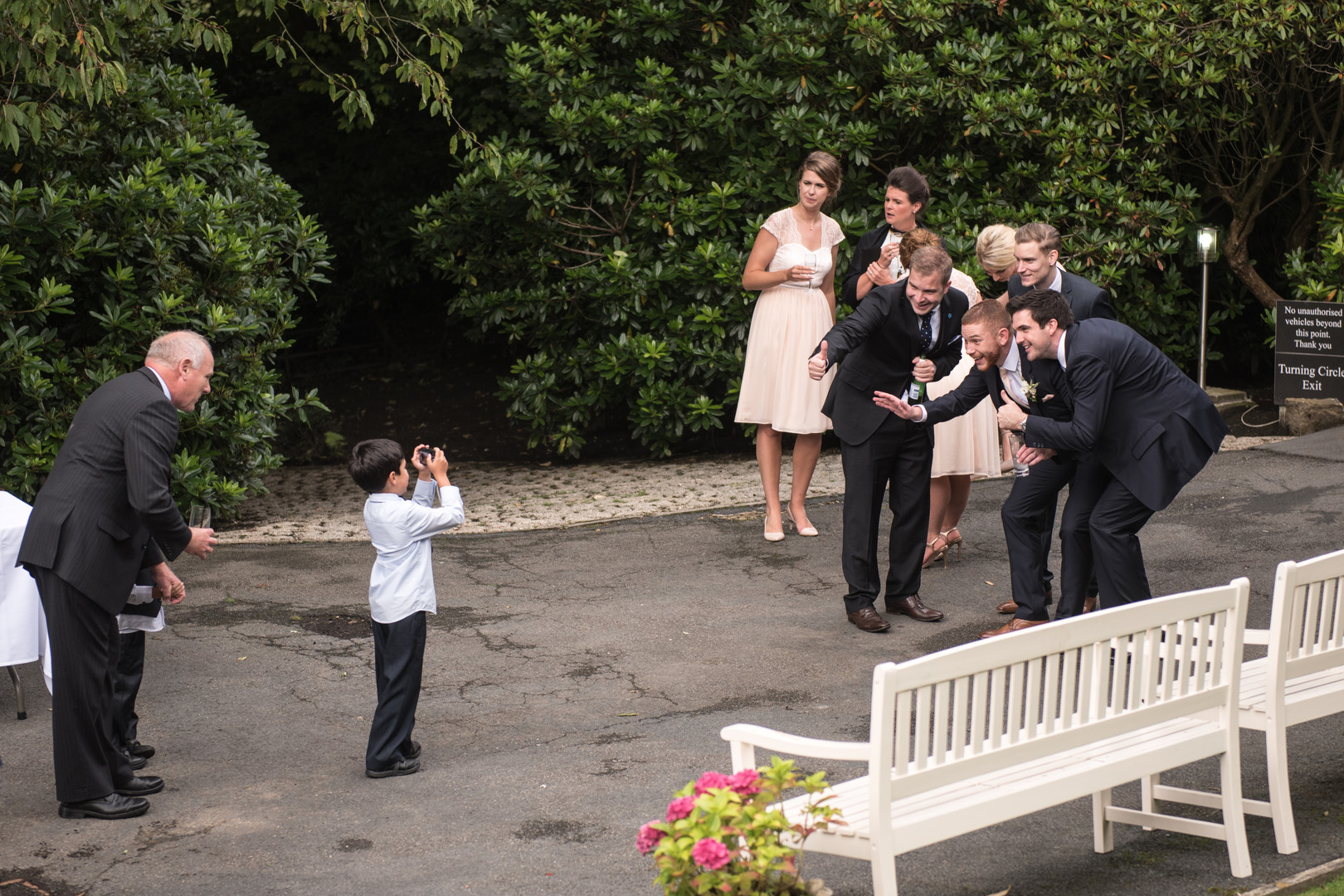 Child takes group photograph