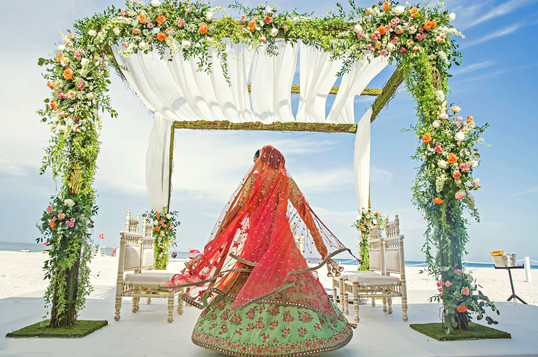 Indian bride showing wedding lehnga sari