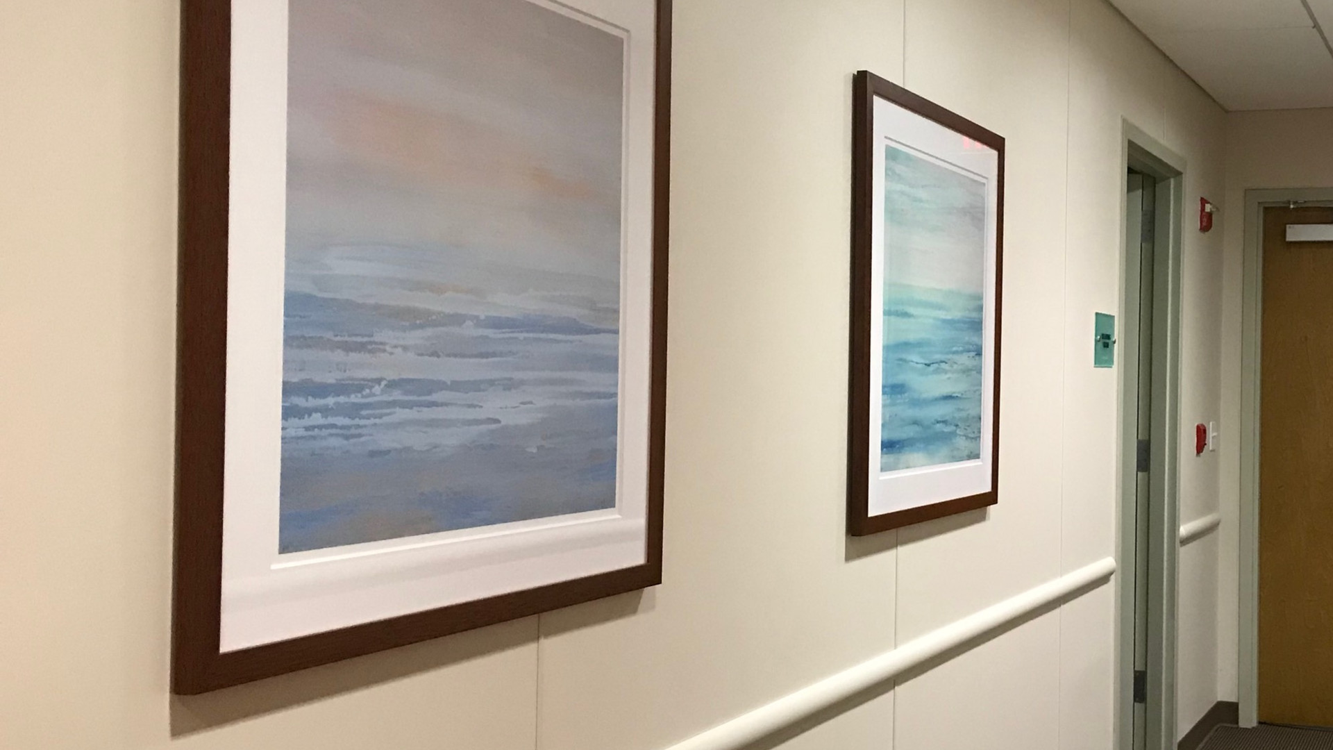 Ocean paintings framed in custom dark wood modern f