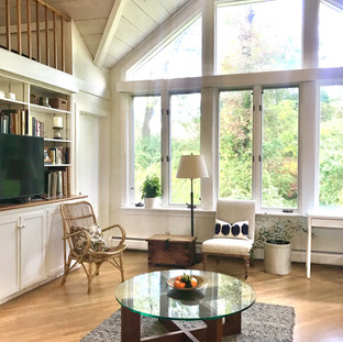 Studio Story: I had fun integrating art works and an eclectic mix of furniture - antiques and mid-century pieces with contemporary lines and shapes into this vaulted ceiling space