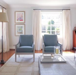 Double hung artworks bring muted color to the living room