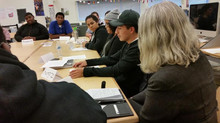 Students at the Metropolitan Business Academy discuss performance-based assessments with teachers an