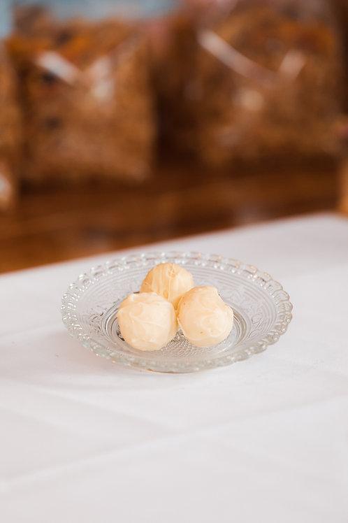 Hemelse truffels Kokos/Sinaasappel (per stuk)