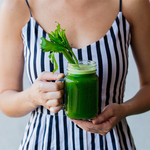 woman-holding-celery-juice-smoothie-732x